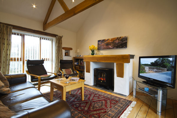 Relax in the lounge area at Gospenheale Barn