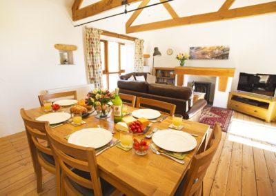 Open plan living area with oak A frames.