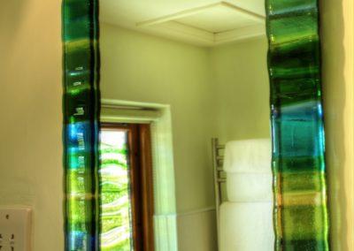 Jo Downs fused glass bathroom windows.